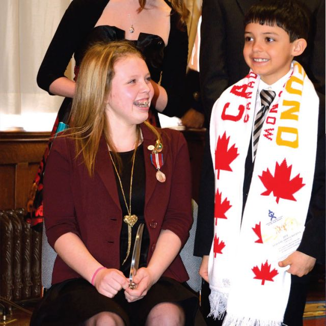 Annaliese Carr, left, was one of 12 recipients of the Ontario Junior Citizen of the Year award. The student from Simcoe, Ont.'s Holy Trinity Catholic High School raised almost $250,000 for Camp Trillium by swimming Lake Ontario last year.