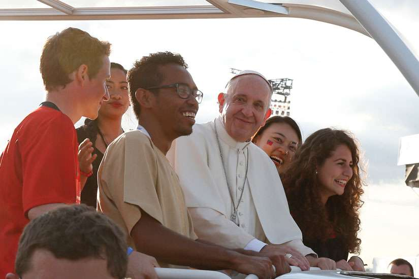Pope Francis arrives with World Youth Day pilgrims for the July 30 prayer vigil at the Field of Mercy in Krakow, Poland.