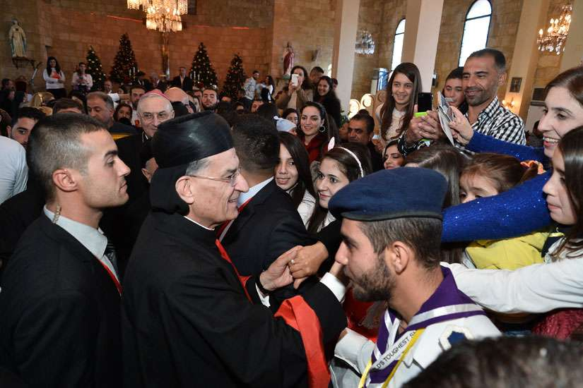 Lebanese Cardinal Bechara Rai, patriarch of the Maronite Catholic Church, greets people after celebrating Mass Dec. 7 at Our Lady of the Annunciation Cathedral in Tartus, Syria. He urged Syrian Christians to hold onto their faith amid the country's conflict, now in its fifth year.