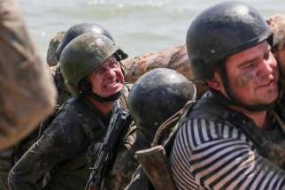 Young Ukrainian Marine recruits are seen on the obstacle course during their training in late May at a shooting range near Mariupol.
