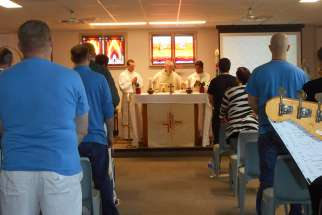 Archbishop Michael Miller celebrates Mass with inmates at a B.C. institution.