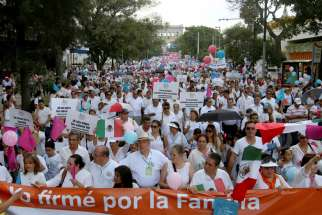 Thousands march against the legalization of same-sex marriage and to defend their interpretation of traditional family values Sept. 11 in Guadalajara, Mexico. Organizers plan a similar protest march Sept. 24 in Mexico City.
