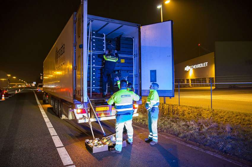 Dutch police search a Spanish truck at the border after nine immigrants were rescued from the freezer of the vehicle in early February in Hazeldonk, Netherlands. The truck driver was arrested as a suspect of human trafficking.