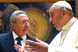 Cuban President Raul Castro smiles as he meets Pope Francis during a private audience at the Vatican May 10.