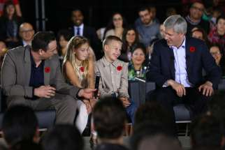 Prime Minister Stephen Harper greets the crowd at the Schwartz/Reisman Community Centre prior to announcing new measures to help make life more affordable for Canadian families.