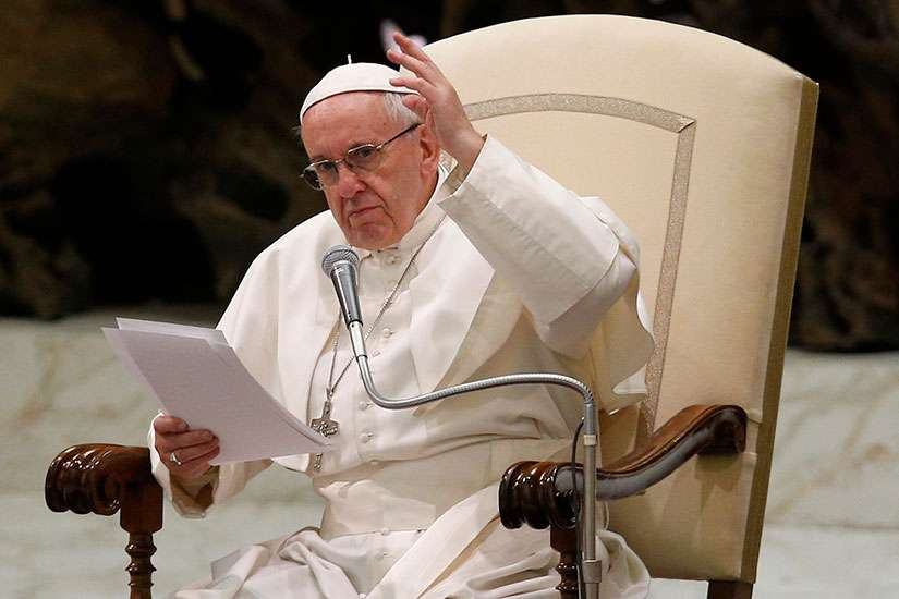 Pope Francis gestures as he leads his general audience in Paul VI hall at the Vatican Feb. 1.