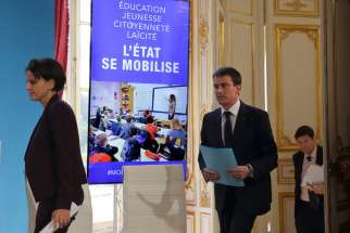 French Prime Minister Manuel Valls and Education and Research Minister Najat Vallaud-Belkacem arrive for a Jan. 22 news conference in Paris to announce new measures aimed at helping schools combat radical Islam, racism and anti-Semitism in reaction to deadly attacks.