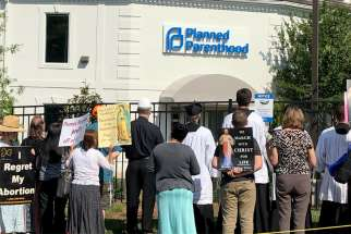 Catholics pray for an end to abortion during a June 15, 2019, procession and rally outside Planned Parenthood's new location in Charlotte, N.C. The facility is larger than its previous location and is located in a historically African American neighborhood of Charlotte. Pro-life groups, grassroots organizations and churches have united in opposition to the new location.