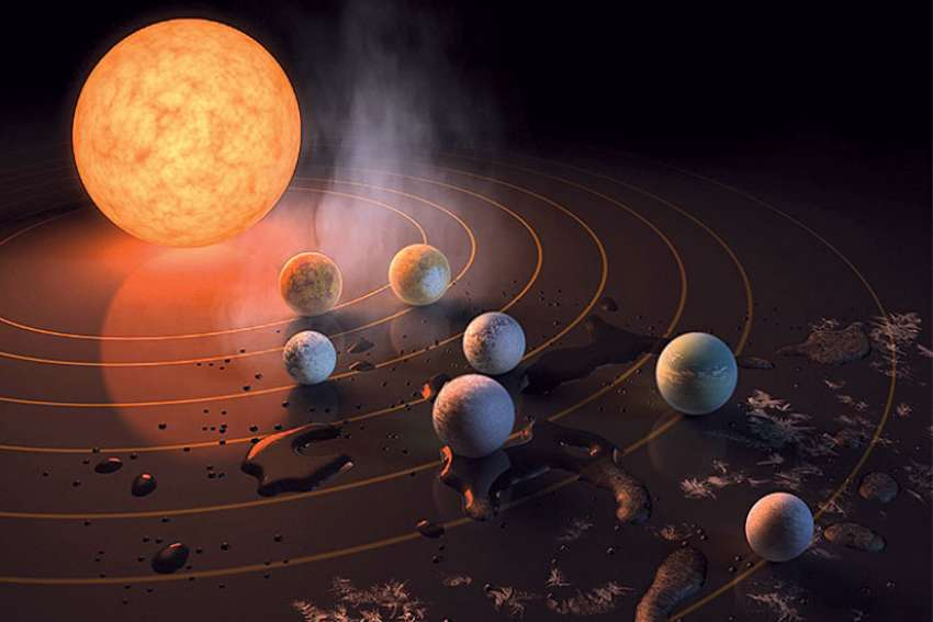 This artist's concept appeared on the February 23rd, 2017 cover of the journal Nature announcing that the TRAPPIST-1 star, an ultra-cool dwarf, has seven Earth-size planets orbiting it.