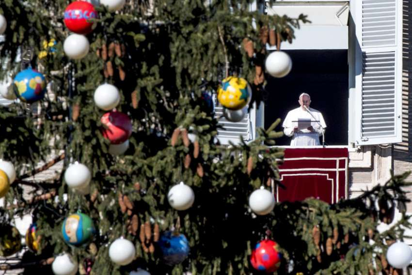 Pope Francis leads the Angelus from the window of his apartment overlooking St. Peter's Square Dec. 18 at the Vatican.