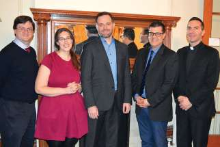 Director Jordan Allott, middle, was the guest of honour at collaboration event with chaplaincy leaders of Ryerson University, Newman Centre and St. Michaels' College.