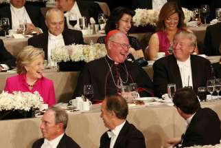 New York Cardinal Timothy M. Dolan shares a light moment with U.S. Democratic presidential nominee Hillary Clinton and Republican presidential nominee Donald Trump during the 71st annual Alfred E. Smith Memorial Foundation Dinner at the Waldorf Astoria hotel in New York City Oct. 20.
