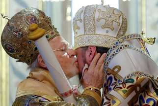 Ecumenical Patriarch Bartholomew of Constantinople kisses Metropolitan Epiphanius, head of the Orthodox Church of Ukraine, Jan. 6, as he hands him a decree granting the Orthodox Church of Ukraine independence, at the Patriarchal Cathedral of St. George in Istanbul, Turkey.