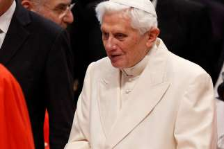 Retired Pope Benedict XVI attends a consistory for the creation of new cardinals in St. Peter's Basilica at the Vatican in this Feb. 22, 2014, file photo.