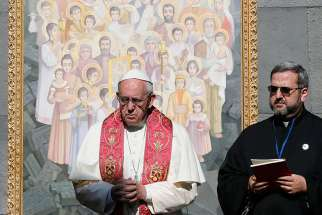 Pope Francis visits the Tsitsernakaberd Memorial in Yerevan, Armenia, June 25. The monument honors the estimaged 1.5 million Armenians killed by Ottoman Turks in 1915-18. The icon behind the pope represents those killed.