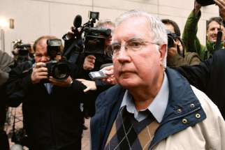 Bishop Raymond Lahey of the Diocese of Antigonish arrives at a police station in Ottawa Oct.1, 2009. Lahey turned himself in to face charges of possession of and importing child pornography.