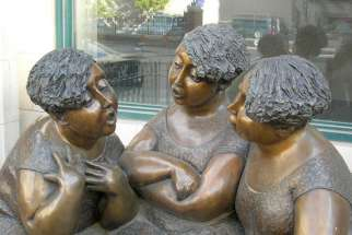 "A sculpture called ""Gossip"" in Winnipeg."