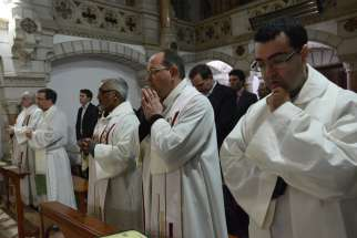 Bishops from around the world pray during a Jan. 12 Mass at the Carmelite Monastery in Bethlehem, West Bank.