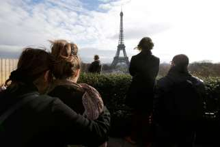 People observe a minute of silence at the Trocadero in Paris Nov. 16.