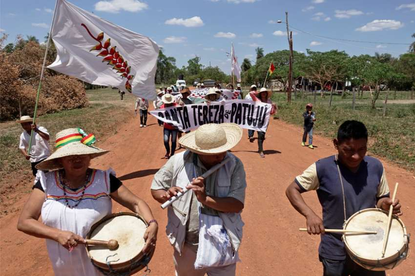 People near San Jose, Bolivia, march to defend Mother Earth Sept. 27, 2019.