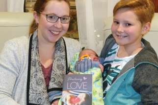 Leah Perrault and daughter Robyn (holding baby brother Atticus) of Holy Family Cathedral Parish in Saskatoon worked together to write a Lenten resource for families entitled Practicing Love.