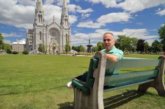 Leonard DiVittorio of the New York borough of Queens poses for a photo July 23 outside the Basilica of Ste.-Anne-de-Beaupre in Quebec. DiVittorio has been organizing the Ahearn Memorial Pilgrimage to the basilica.