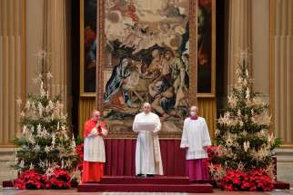 "Pope Francis delivers his Christmas message and blessing ""urbi et orbi"" (to the city and the world) from the Hall of Blessings at the Vatican Dec. 25, 2020. Also pictured are Cardinal Angelo Comastri, archpriest of St. Peter's Basilica, and Msgr. Guido Marini, papal master of ceremonies."