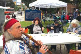"A visitor to the ""pop-up"" restaurant in downtown Toronto adds some flute music to the festivities."