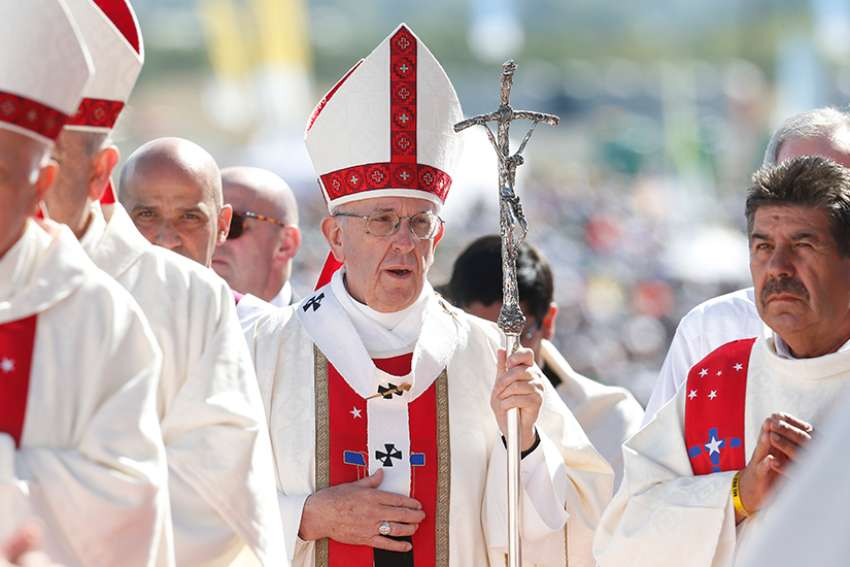 "Pope Francis arrives in procession to celebrate Mass in Chile Jan 17. The Pope said it has been a ""time of listening and discernment"" for the church to get to the root of the sexual abuse crisis in the Chilean church"