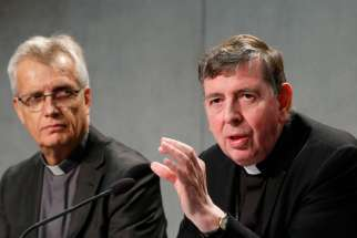 Cardinal Kurt Koch, right, speaks as the Rev. Martin Junge, general secretary of the Lutheran World Federation, looks on during a news conference at the Vatican Oct. 26. During Pope Francis' trip to Sweden, the cardinal was asked about the possibility of Catholics and Lutherans receiving Communion together.