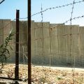 The Israeli security wall is supplemented by barbed wire near Bethlehem in the West Bank.