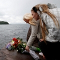People place flowers near Norway's Utoya Island July 24. 76 people died after a gunman opened fire at a youth camp on the island hours after a bomb blast in the government district in the capital of Oslo.