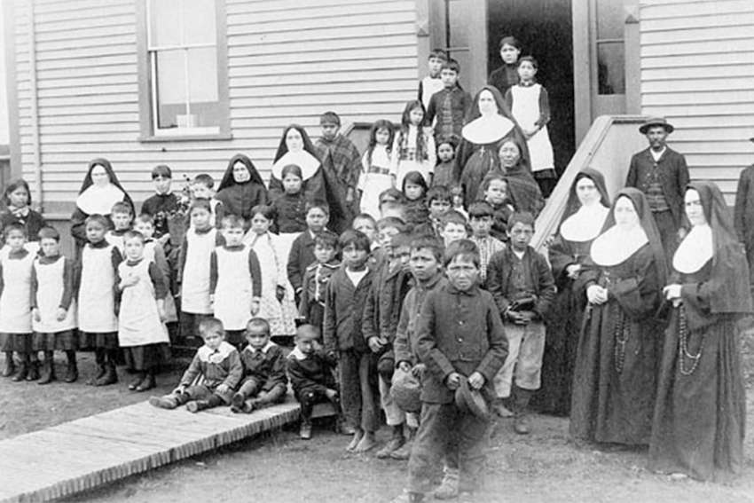 A group of nuns with Aboriginal students, Port Harrison, Quebec, circa 1890.