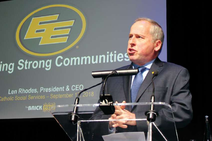 Len Rhodes, president of the Edmonton Eskimos, speaks at the Edmonton Catholic Social Services general meeting Sept. 17.