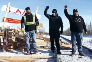 Supporters of the Wet'suwet'en Nation's hereditary chiefs gesture as they camp at a railway blockade near Edmonton last month, part of protests against British Columbia's Coastal GasLink pipeline.