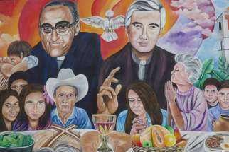 A mural in El Paisnal, El Salvador, seen in this Jan. 29 photo, features Blessed Oscar Romero and town native Father Rutilio Grande, surrounded by rural men, women and children, the community.