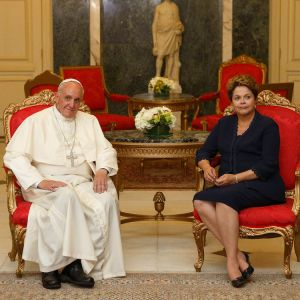 Pope Francis and Brazil's President Dilma Rousseff pose during a photo opportunity at the Guanabara Palace in Rio de Janeiro July 22. The pope is making his first international trip, joining more than 300,000 young people from around the globe for World Youth Day.