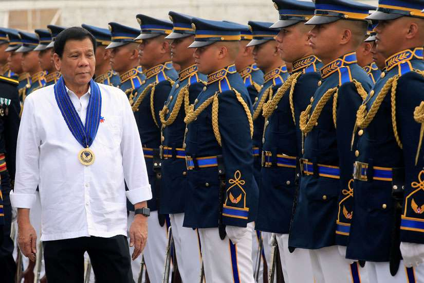 "Philippine President Rodrigo Duterte reviews honor guards upon his arrival at the Villamor air base in Manila. The head of the Philippine bishops' conference set ""ethical guidelines"" against proposals to reinstate the death penalty as the country's war on drugs continues, with body counts increasing daily."