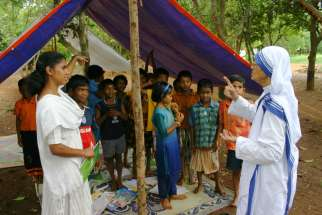 In this 2008 file photo, Missionaries of Charity Sister Nirmala Joshi meets Christian refugees who had been sheltered in Kandhamal, India. Sister Nirmala, 80, died June 23. She would have turned 81 in a month.