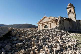 St. Anthony Cchurch is seen Oct. 30 partially collapsed following an earthquake along the road to Norcia, Italy. Thousands of people in central Italy have spent the night in cars, tents and temporary shelters following the fourth earthquake in the area in three months.