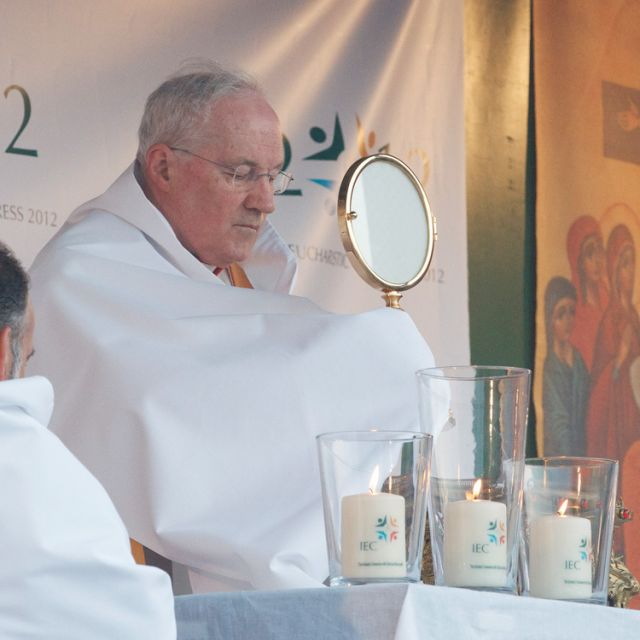 Cardinal Marc Ouellet, prefect of the Vatican's Congregation for Bishops, presides over an exposition of the Eucharist during the 50th International Eucharistic Congress in Dublin June 13.