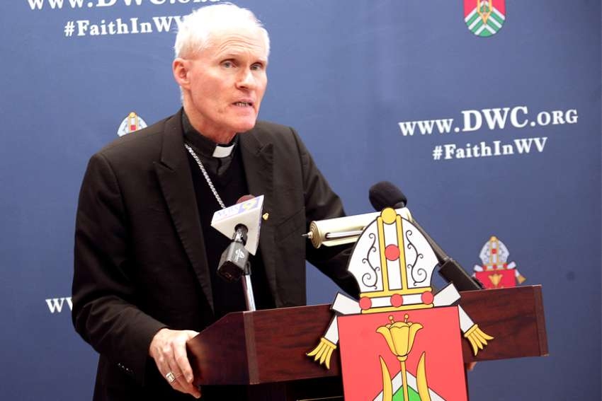 Bishop Mark E. Brennan of Wheeling-Charleston, W.Va., speaks during a news conference at the chancery Nov. 26, 2019, in Wheeling, W.Va.