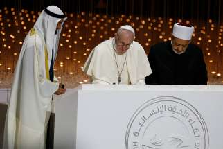 Sheik Mohammed bin Zayed Al Nahyan, crown prince of United Arab Emirates, Pope Francis and Sheik Ahmad el-Tayeb, grand imam of Egypt's al-Azhar mosque and university, sign documents during an interreligious meeting at the Founder's Memorial in Abu Dhabi, United Arab Emirates, Feb. 4, 2019.