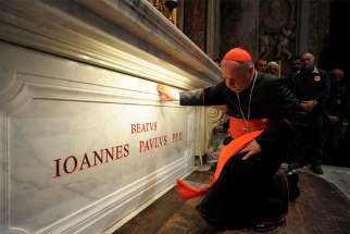 "Polish Cardinal Stanislaw Dziwisz prays at the tomb of St. John Paul II in St. Peter's Basilica at the Vatican May 3, 2011. Cardinal Dziwisz issued a statement March 20 vigorously defending the pontiff from ""hurtful and historically untrue"" claims that he was ""slack"" in combating sexual abuse by Catholic clergy."