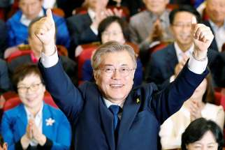 South Korean President-elect Moon Jae-in celebrates in Seoul after declaring victory May 9 in the South Korean presidential election. He was sworn in May 10.