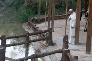 Pope Francis makes the Sign of the Cross in 2014 after praying at Bethany Beyond the Jordan, which UNESCO just declared a World Heritage site and the location of Jesus' baptism.