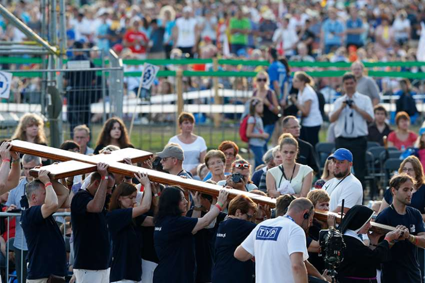The cross is carried in procession during the Way of the Cross at World Youth Day in Blonia Park in Krakow, Poland, July 29, 2016.