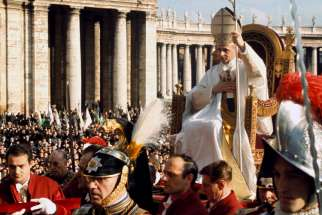 "ope Paul VI is carried on the ""sedia gestatoria,"" a ceremonial throne, during the closing liturgy of the Second Vatican Council in St. Peter's Square at the Vatican Dec. 8,1965. Pope Francis will beatify Pope Paul Oct. 19 during the closing Mass of the extraordinary Synod of Bishops on the family. The miracle needed for Pope Paul's beatification involved the birth of a healthy baby to a mother in California after doctors had said both lives were at risk."