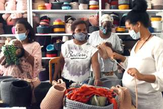 African women work in Kuchinate, the African Women Refugee collective, in Tel Aviv, Israel, July 14, 2020. The collective's work with asylum-seekers, supported by several Catholic charities, has become even more critical during the COVID-19 pandemic.