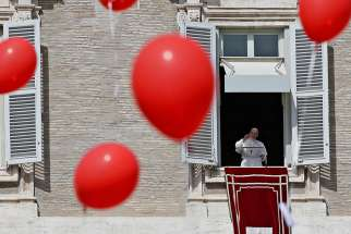 Pope Francis leads the Angelus from the window of his studio overlooking St. Peter's Square March 11 at the Vatican.